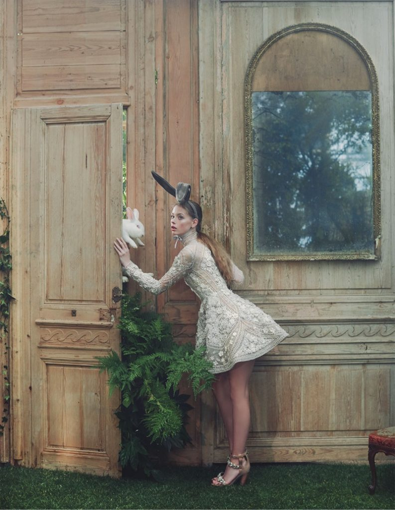 Alice-Wonderland-Fashion-Editorial Greeted by a rabbit, the model wears an Elie Saab dress with Simon Azoulay bunny ears